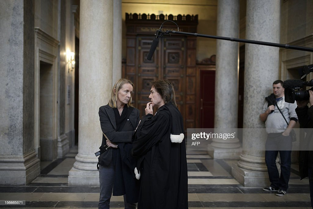 French former tennis player Isabelle Demongeot (C) discusses with civil party lawyer Jean-Claude Guidicelli (C,R) outside a courtroom on November 23, 2012 at Lyon's courthouse, while waiting for the verdict in the trial of former tennis coach Regis de Camaret, who appears for rapes on two under-age women, twenty years ago.