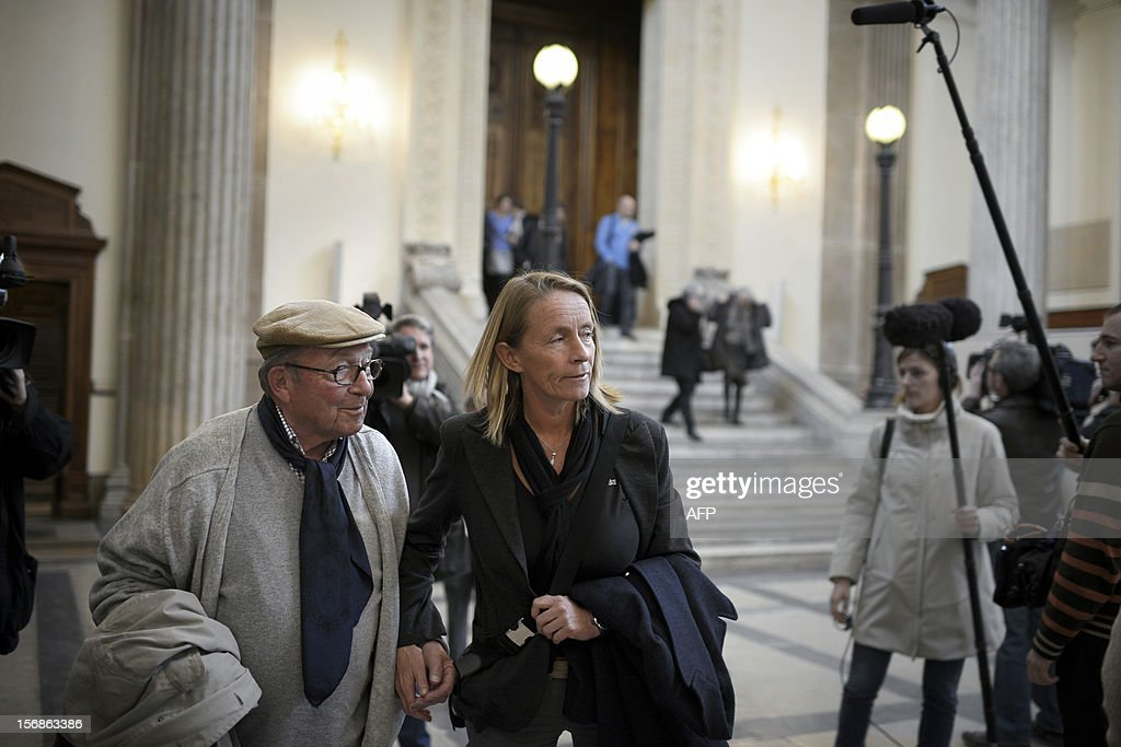 French former tennis player Isabelle Demongeot (C) leaves a courtroom on November 23, 2012 at Lyon's courthouse, to wait for the verdict in the trial of former tennis coach Regis de Camaret, who appears for rapes on two under-age women, twenty years ago.