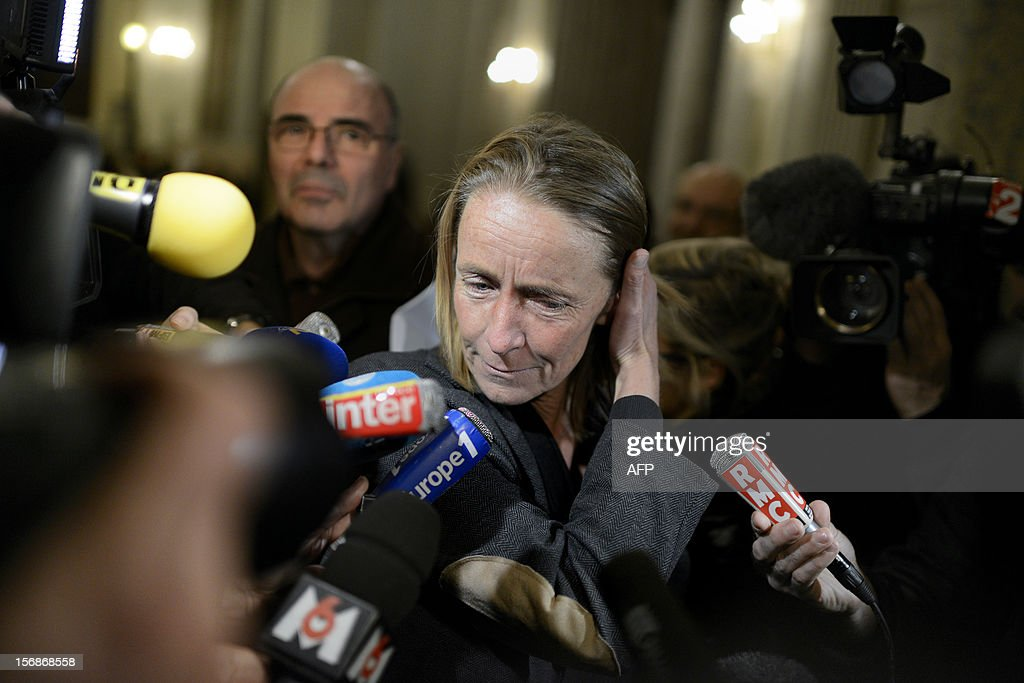 French former tennis player Isabelle Demongeot reacts as she leaves the courtroom, on November 23, 2012 at the Lyon courthouse, at the end of the trial of Regis de Camaret, former tennis coach who appeared for rapes on two under-age women, including Demongeot, 20 years ago. Camaret was condamned to 8 years in prison.
