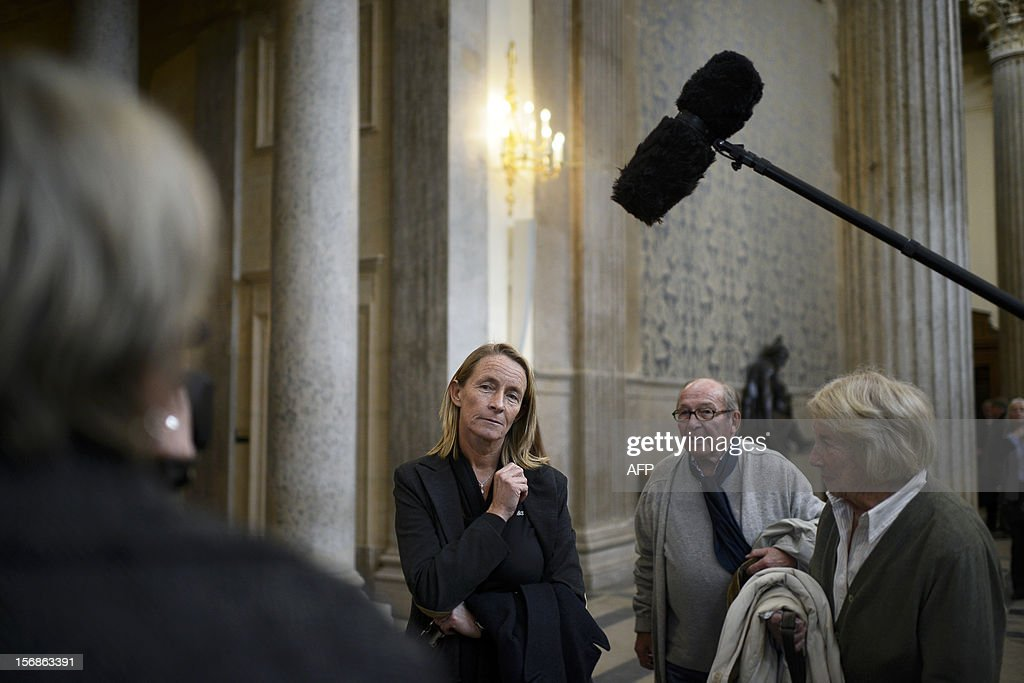 French former tennis player Isabelle Demongeot (C) waits outside a courtroom on November 23, 2012 at Lyon's courthouse, for the verdict in the trial of former tennis coach Regis de Camaret, who appears for rapes on two under-age women, twenty years ago.