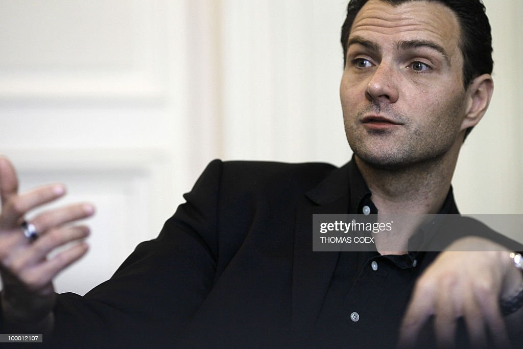 French former trader at Societe Generale bank, Jerome Kerviel gestures during an interview on May 20, 2010 at his lawyer's office in Paris. Kerviel, who will appear in court in Paris from June 8 to 25, 2010, faces a maximum sentence of five years in prison and a fine of 375,000 euros if convicted on charges of breach of trust, falsifying and using fake documents and tampering with computer information.