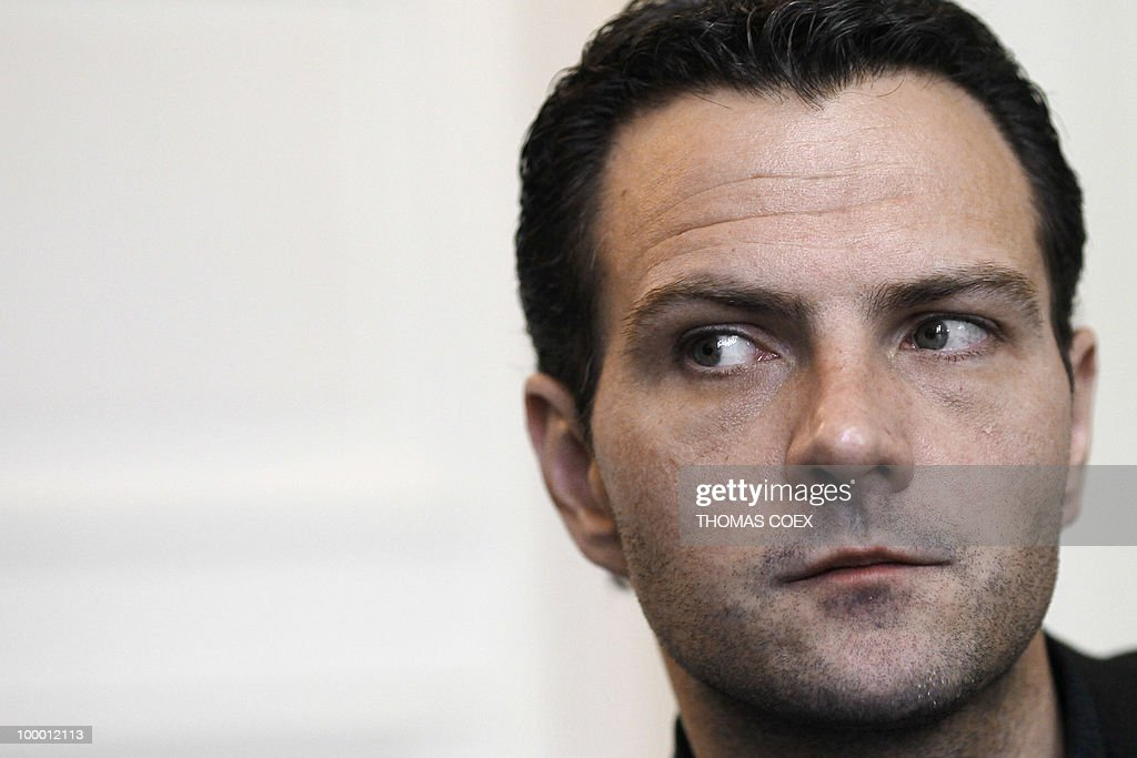 French former trader at Societe Generale bank, Jerome Kerviel listens during an interview on May 20, 2010 at his lawyer's office in Paris. Kerviel, who will appear in court in Paris from June 8 to 25, 2010, faces a maximum sentence of five years in prison and a fine of 375,000 euros if convicted on charges of breach of trust, falsifying and using fake documents and tampering with computer information.