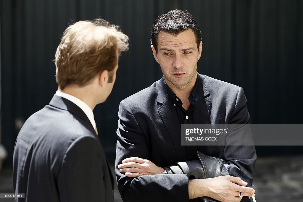 French former trader at Societe Generale bank, Jerome Kerviel (R) talks with one of his lawyers, Nicolas Huc-Morel on May 20, 2010 in Paris. Kerviel, who will appear in court in Paris from June 8 to 25, 2010, faces a maximum sentence of five years in prison and a fine of 375,000 euros if convicted on charges of breach of trust, falsifying and using fake documents and tampering with computer information.