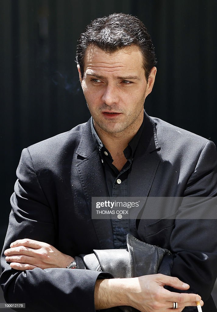 French former trader at Societe Generale bank, Jerome Kerviel talks with one of his lawyers (unseen) on May 20, 2010 in Paris. Kerviel, who will appear in court in Paris from June 8 to 25, 2010, faces a maximum sentence of five years in prison and a fine of 375,000 euros if convicted on charges of breach of trust, falsifying and using fake documents and tampering with computer information.