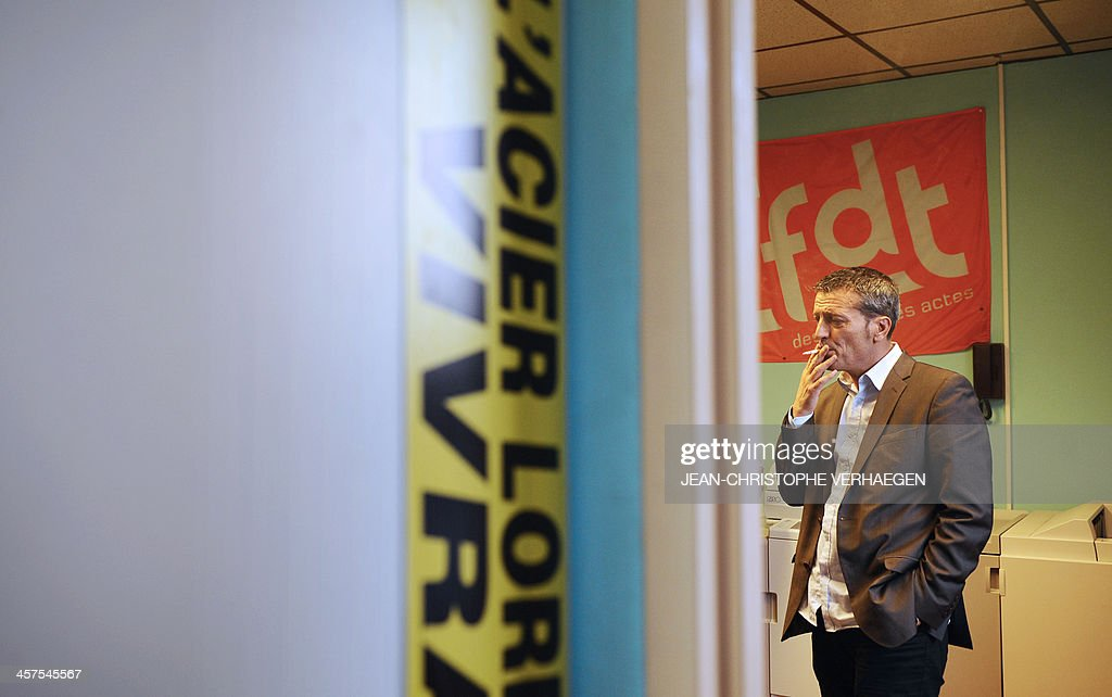 French former union representative Edouard Martin socialist candidate for the 2014 european elections smokes in the CFDT ArcelorMittal headquarters...