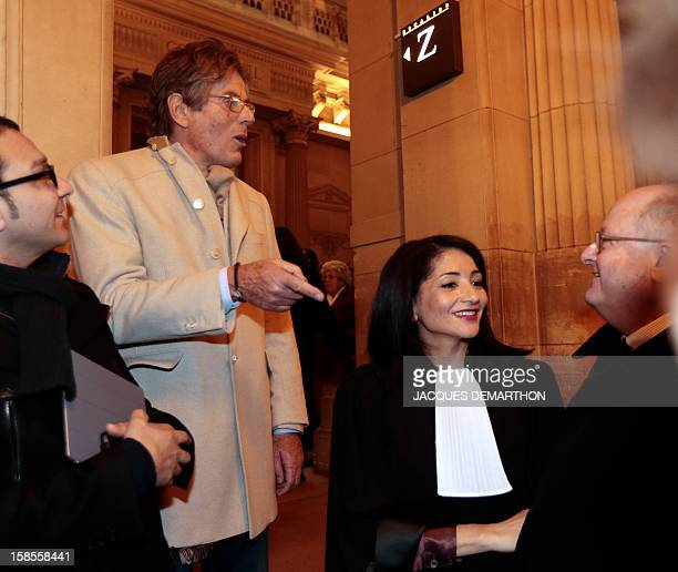 French former Youth and Associations Junior Minister Jeannette Bougrab speaks with Dominique Desseigne after she takes an oath as lawyer at the Paris...
