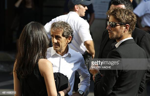 French Formula 1 legend Alain Prost arrrives with French driver Romain Grosjean and his wife Marion Jolles to attend the funeral of late French...