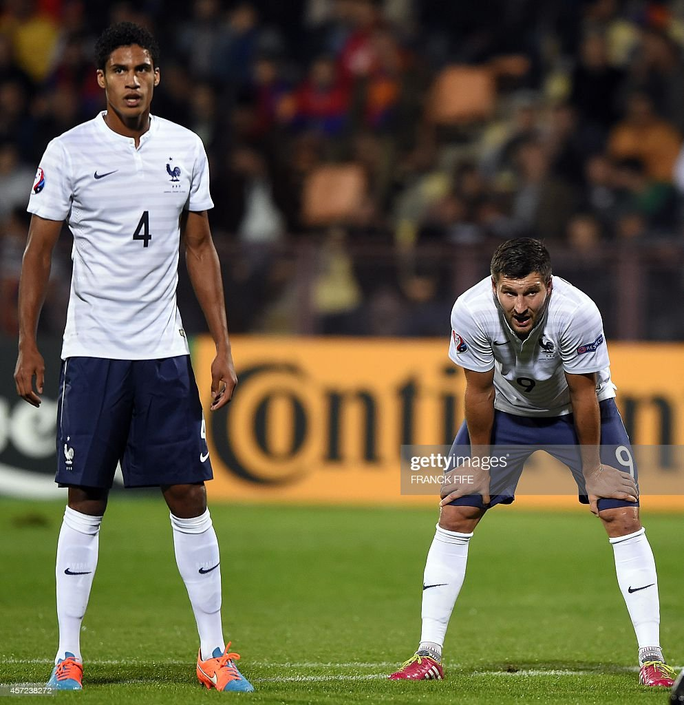 French forward Andre Pierre Gignac R and French defender Raphael