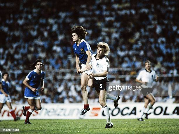 French forward Didier Six vies with West German player during the 1982 World Cup semifinal football match between West Germany and France on July 8...