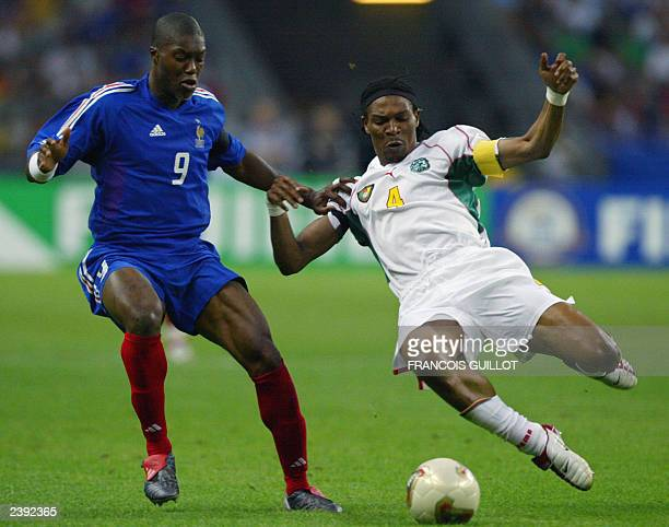 French forward Djibril Cisse vies with Cameroonian defender and captain Rigobert Song during their soccer Confederations Cup final match 29 June 2003...