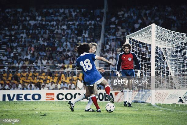 French forward Dominique Rocheteau runs with ball during the 1982 World Cup semifinal football match between West Germany and France on July 8 1982...