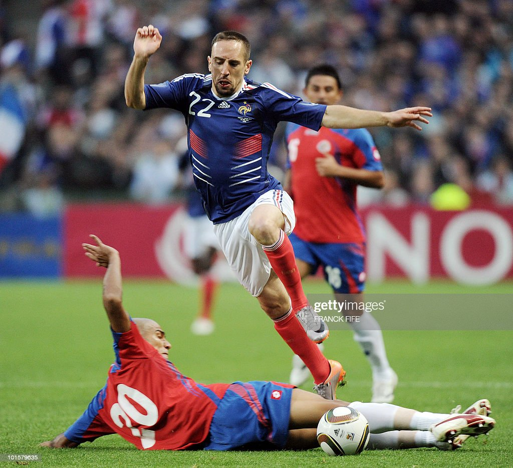 French forward Franck Ribery (up) vies with Costa-Rica's defender Douglas Sequeira during the friendly football match France vs. Costa-Rica at the Bollaert Stadium in Lens on May 26, 2010, ahead of the upcoming WC2010 in South Africa.