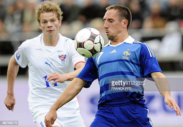 French forward Franck Ribery vies with Faroe's midfielder Einar Hansen during the World Cup 2010 qualifying football match France vs Faroe Islands on...