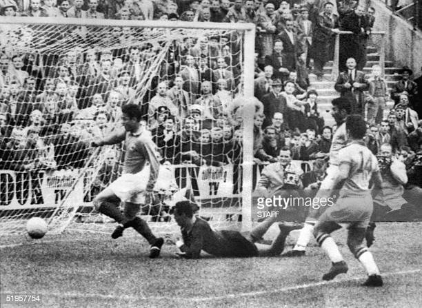 French forward Just Fontaine celebrates after scoring a goal past Brazilian goalkeeper Gilmar and defender Nilton De Sordi to tie the score at 1...