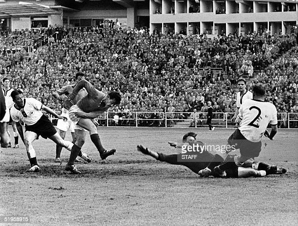 French forward Just Fontaine scores the third goal for his team past West German goalkeeper Heiner Kwiatkowski during the World Cup soccer match for...