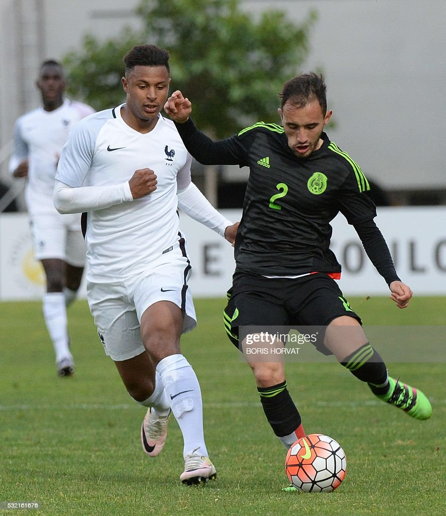 French forward Lys Mousset L vies with Mexican defender Carlos