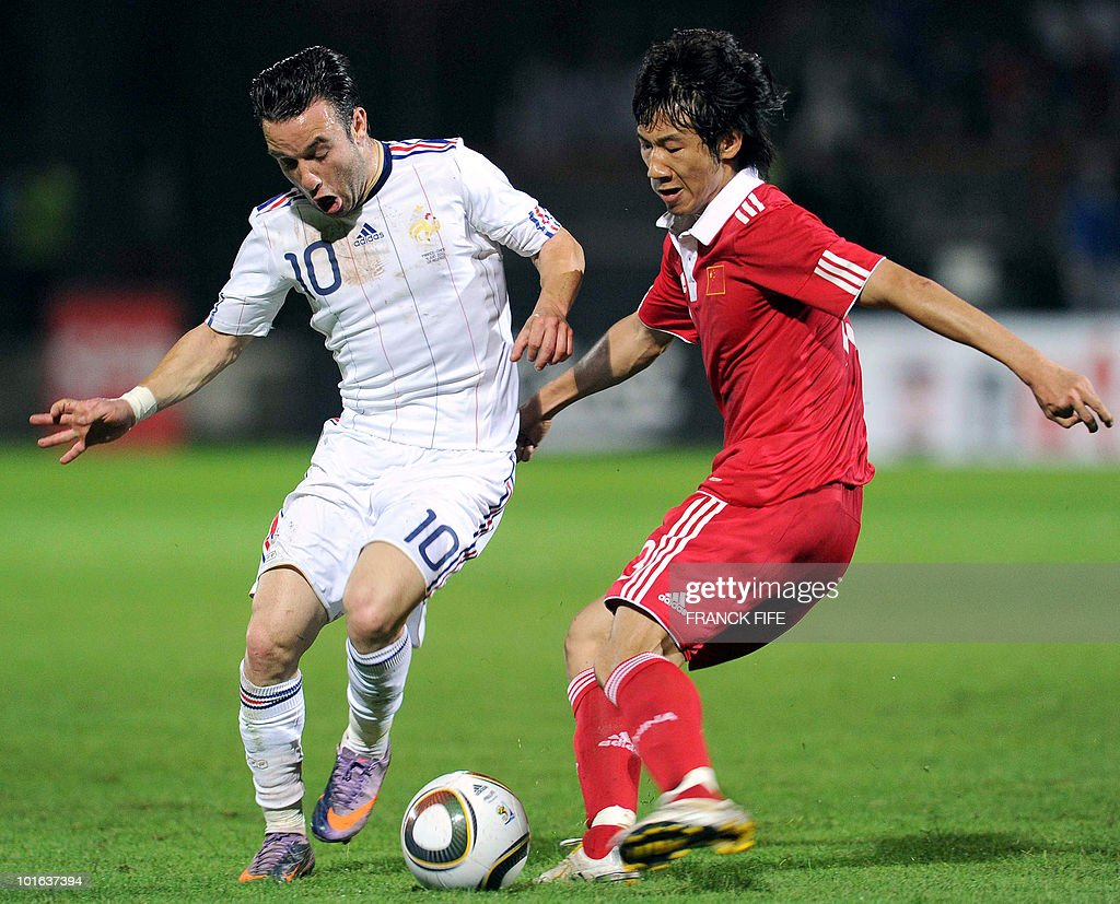 French forward Mathieu Valbuena (L) vies with Chinese midfielder Rong Hao during their friendly football match France vs China at the Michel Volnay Stadium in Saint-Pierre, on the French Indian Ocean island of La Reunion, on June 4, 2010 ahead of the FIFA 2010 World Cup in South Africa. China won 0-1.