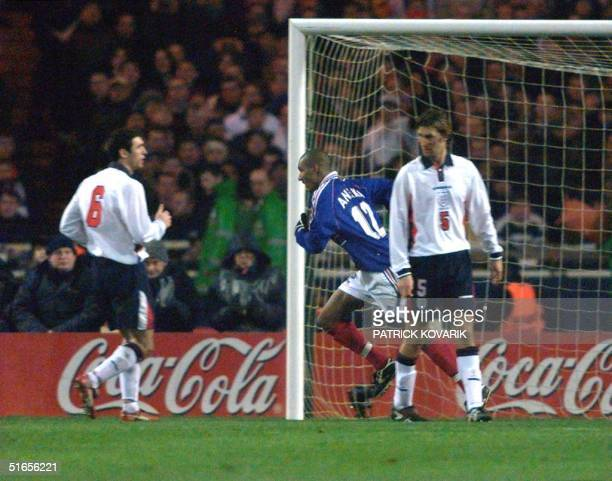 French forward Nicolas Anelka jubilates after scoring his second goal as English defenders Martin Keown and Tony Adams look at each other 10 February...