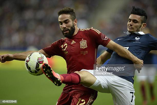 French forward Remy Cabella vies with Spanish defender Daniel Carvajal during the friendly football match France vs Spain on September 4 2014 at the...