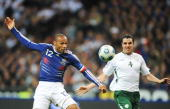 French forward Thierry Henry controls the ball in front of Irish defender John O'Shea during the World Cup 2010 qualifying football match France vs...