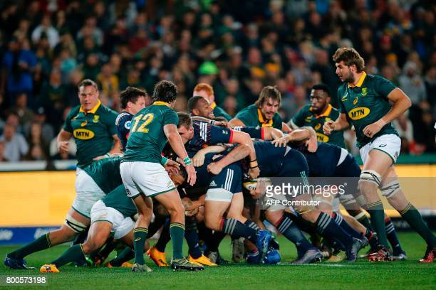 French forwards are watched by South Africa's Jan Serfontein as they drive a maul forward during the third rugby union Test match between South...