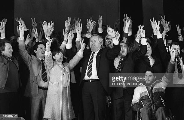 French founder and president of farrighter National Front JeanMarie Le Pen rises his arms along with the party's candidates for the European...