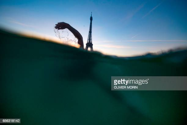 French freediver and Iceswimmer Alexandre Voyer swims in the icy frozen waters of the Trocadero fountain near the Eiffel Tower in Paris on January 6...
