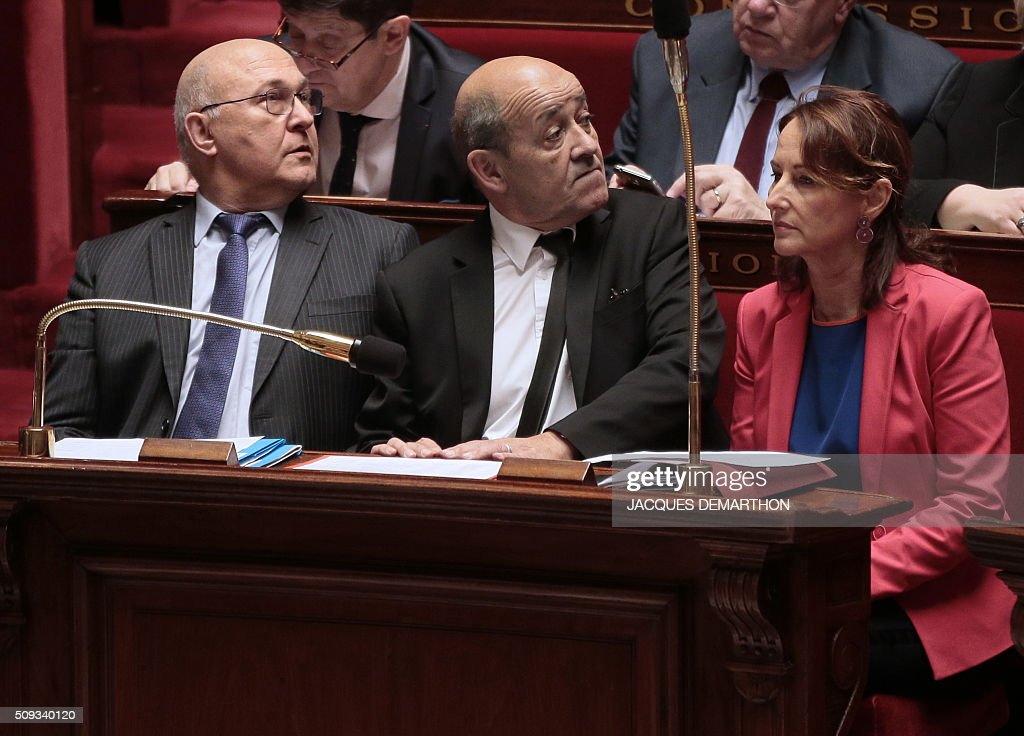 French French Finance minister Michel Sapin, French Defence minister Jean-Yves Le Drian and French minister for Ecology, Sustainable Development and Energy Segolene Royal attend the questions to the government at the National Assembly in Paris on February 10, 2016. French lawmakers were to vote on February 10 on a controversial package of measures to change the constitution following the terror attacks on Paris in November. / AFP / JACQUES DEMARTHON