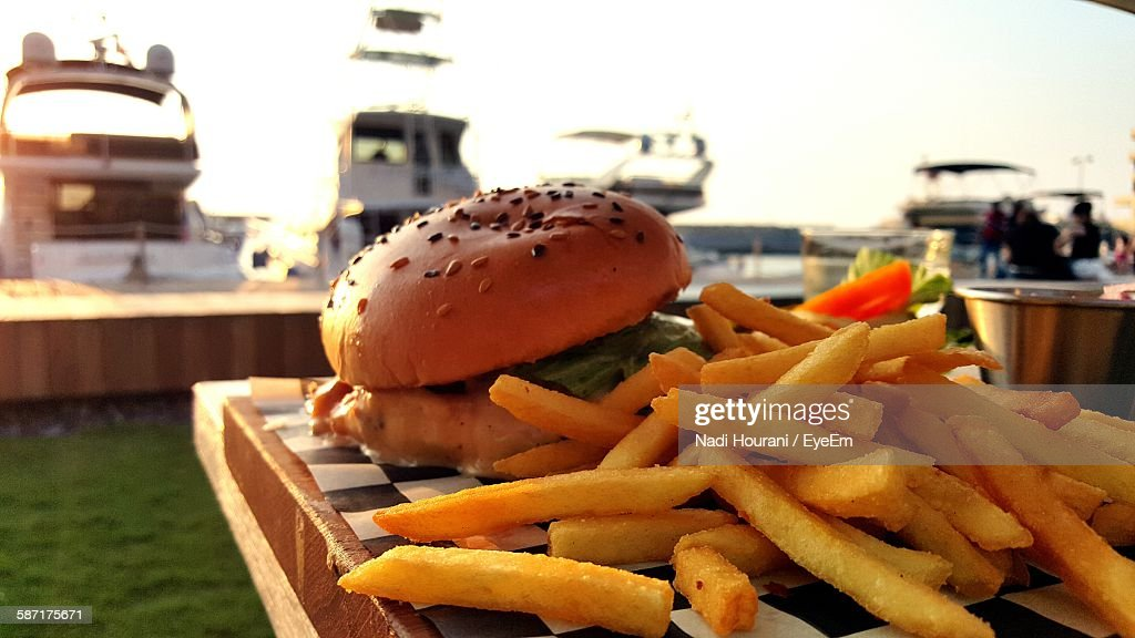French Fries And Burger On Table