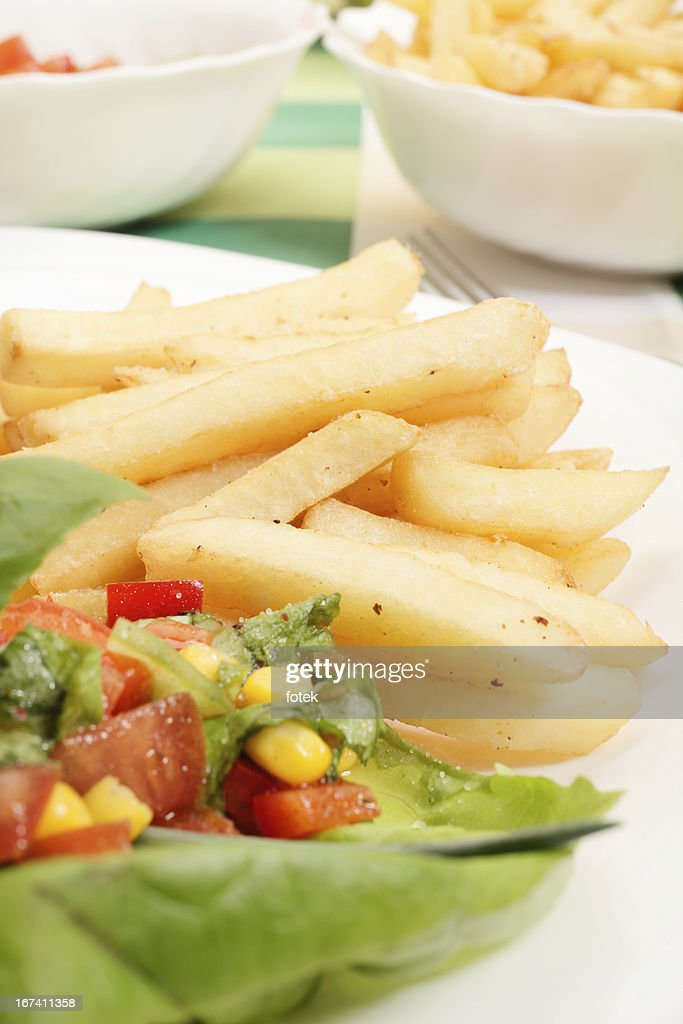 French fries and salad : Stock Photo