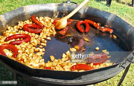 French fries and sausages in a pan : Stock Photo