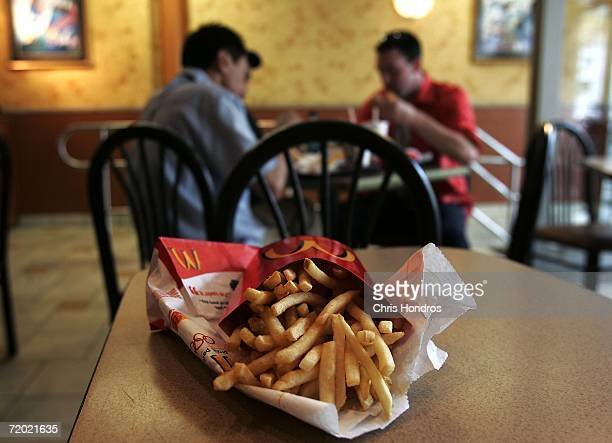 French fries are displayed on a table as diners eat food in a McDonald's restaurant September 27 2006 in New York City The city health department is...