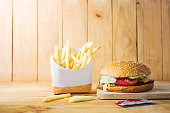 French fries , Burger,Fast Food on a Wooden Chopping Board