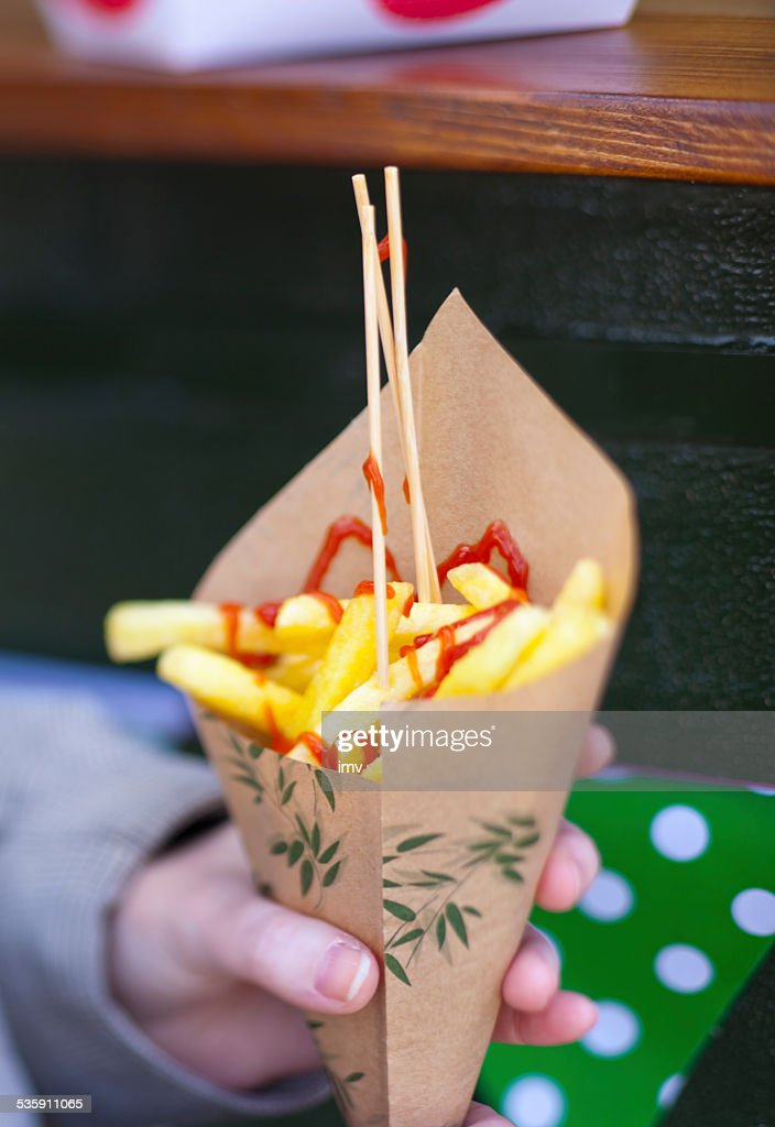 French fries in a paper cone. : Stock Photo