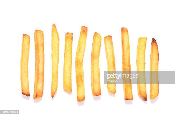 French fries in a row on white background