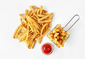 French fries in basket with ketchup isolated on white background. Top flat view.