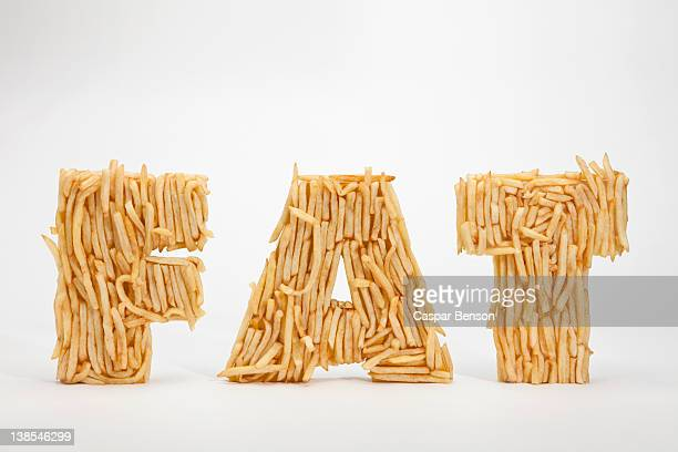 French fries molded to make the word FAT