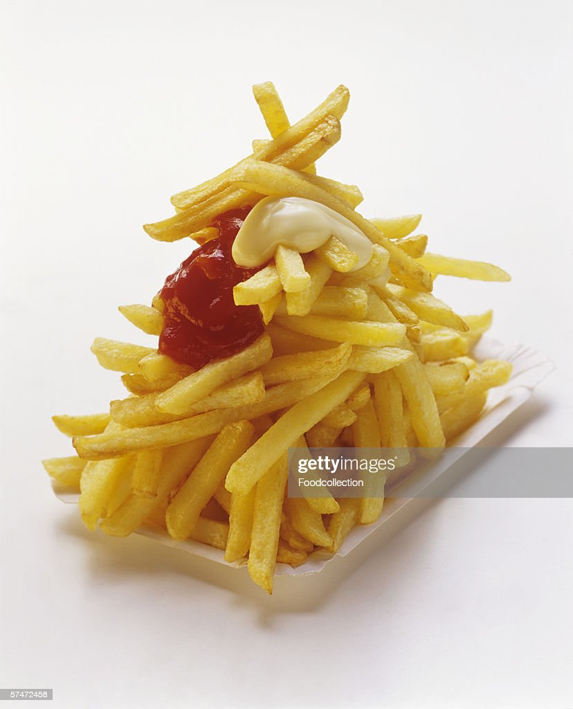 French Fries on a Paper Plate with Ketchup and Mayonnaise : Stock Photo