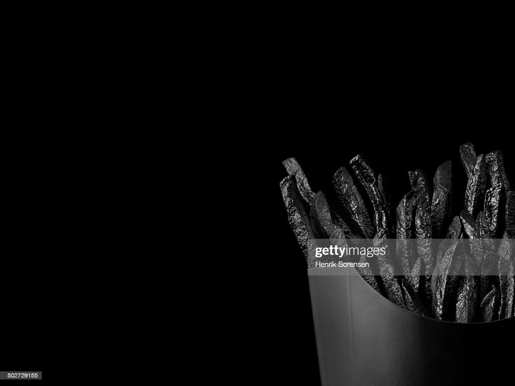 French fries on black backdrop