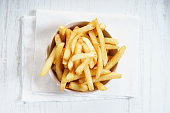 French fries with ketchup and fresh rosemary