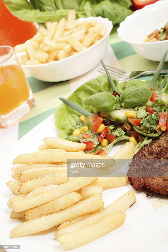 French fries, salad and chop : Stockfoto
