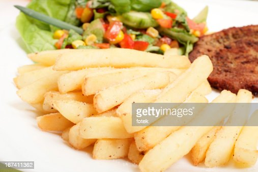 French fries, salad and chop : Stock Photo