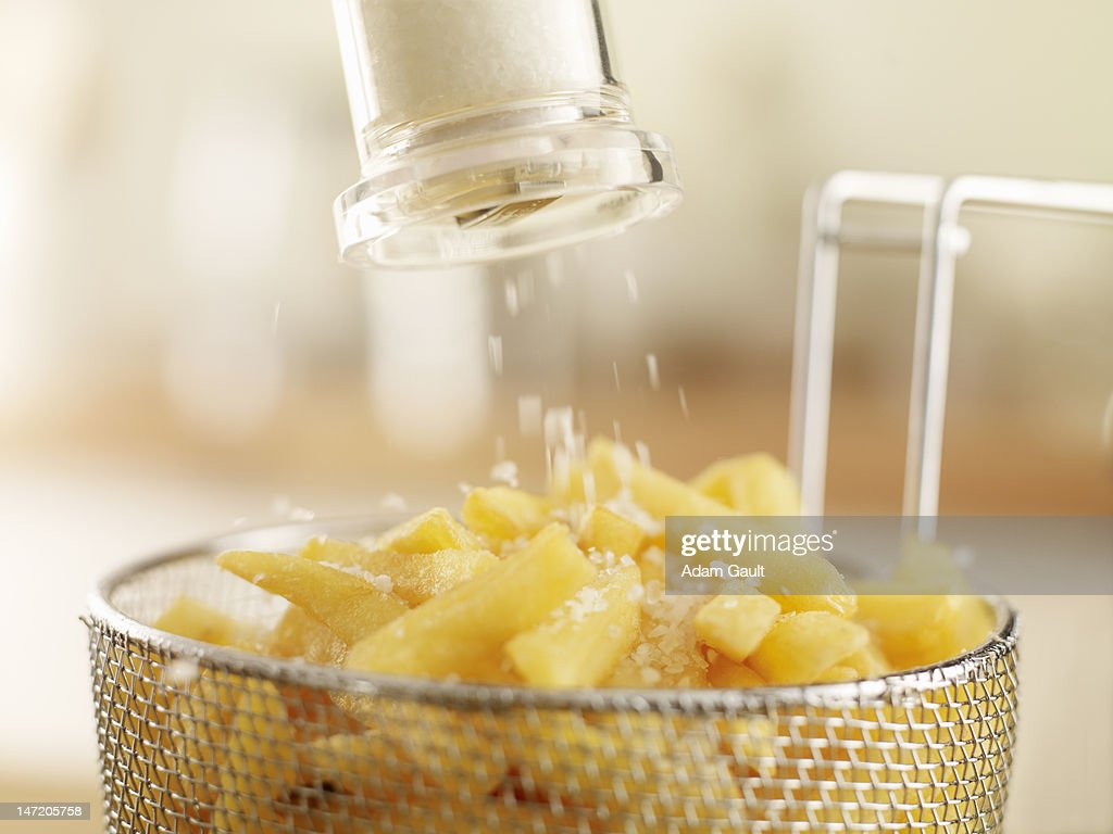 French fries sprinkled with salt : Stock Photo