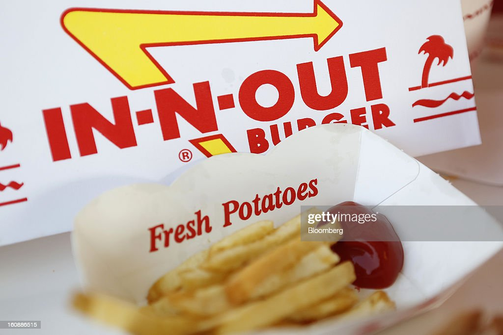 French fries with ketchup are arranged for a photograph at an In-N-Out Burger restaurant in Costa Mesa, California, U.S., on Wednesday, Feb. 6, 2013. In-N-Out, with almost 280 units in five states, is valued at about $1.1 billion based on the average price-to-earnings, according to the Bloomberg Billionaires Index. Photographer: Patrick T. Fallon/Bloomberg via Getty Images
