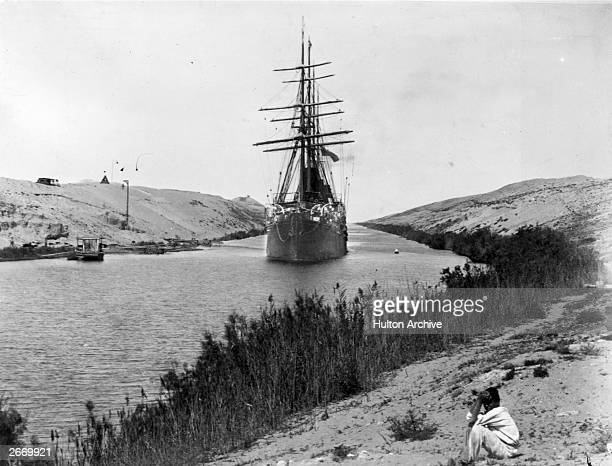 A French frigate passes through the Channel of the Suez Canal opened in 1869