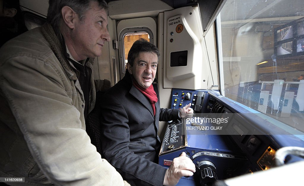 French Front de Gauche candidate for the 2012 French presidential election, Jean-Luc Melenchon, poses in the driver cab of a RER train (Regional Express Network) as it goes to Massy-Palaiseau, Paris suburb, in order to meet unions delegation of the RATP (Autonomous Operator of Parisian Transports) on March 20, 2012.