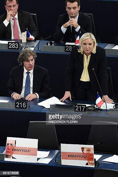 French Front National farright party's President and Member of the European Parliament Marine le Pen deliverss a speech near empty seats displaying...