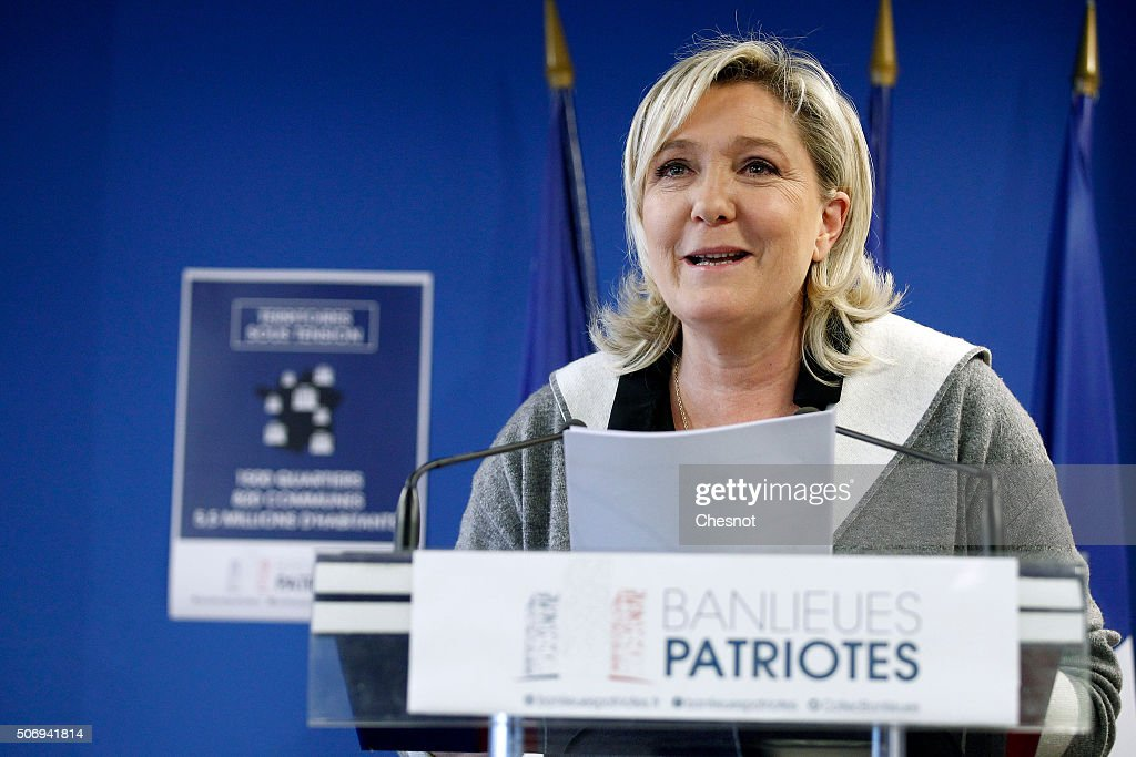 French Front National (FN) far-right party's President <a gi-track='captionPersonalityLinkClicked' href=/galleries/search?phrase=Marine+Le+Pen&family=editorial&specificpeople=588282 ng-click='$event.stopPropagation()'>Marine Le Pen</a> delivers a speech during a press conference at the FN headquarters on January 26, 2016 in Nanterre, France. <a gi-track='captionPersonalityLinkClicked' href=/galleries/search?phrase=Marine+Le+Pen&family=editorial&specificpeople=588282 ng-click='$event.stopPropagation()'>Marine Le Pen</a> advocated a 'comprehensive national policy for the City' to the suburbs to mark the launch of a collective 'patriots Suburbs'.