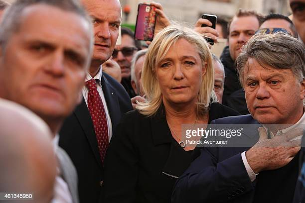 French Front National party president Marine Le Pen takes part in a Unity rally 'Marche Republicaine' on January 11 2015 in Beaucaire France The...
