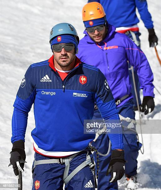 French fullback Scott Spedding walks down the Grande Motte glacier during the French rugby union team's training camp in Tignes southeastern France...
